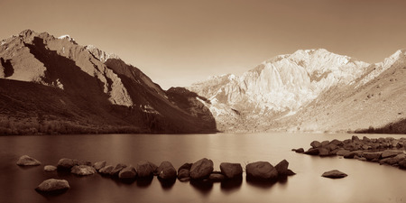 sierra nevada mountain range: Snow mountain and lake with reflections in Yosemite panorama BW.