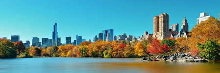 fall foliage: Central Park Autumn and midtown skyline over lake in Manhattan New York City Stock Photo