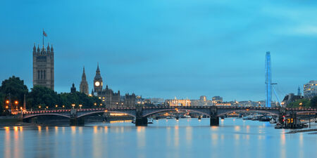 london eye: Thames River panorama with London Eye and Westminster Palace in London.