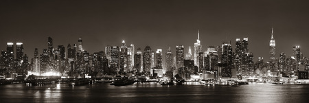 new york city panorama: Midtown Manhattan skyline in black and white at dusk panorama over Hudson River