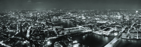 London aerial view panorama at night with urban architectures and bridges. Фото со стока
