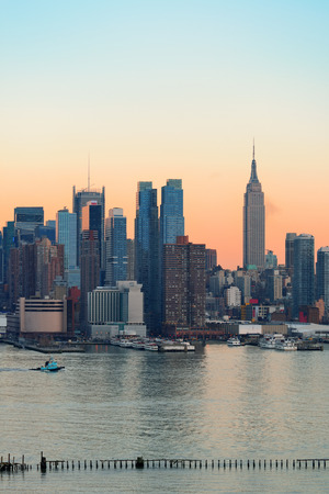 times square: New York City midtown Manhattan sunset skyline panorama view over Hudson River