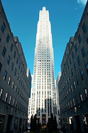 declared: NEW YORK CITY, NY - MAR 30: Rockefeller Plaza street view on March 30, 2014 in New York City. Declared a National Historic Landmark in 1987, it is a complex of 19 commercial buildings