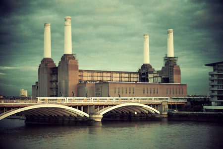 abandoned factory: Battersea Power Station over Thames river as the famous London landmark. Editorial