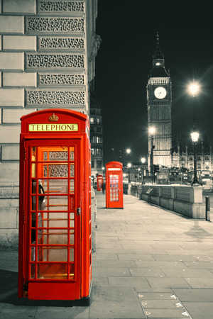 Red telephone box and Big Ben in Westminster in London. photo