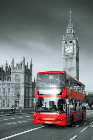 westminster: Double-deck red bus on Westminster Bridge with Big Ben in London.