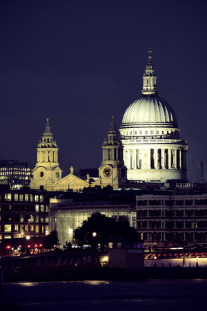 thames: St Pauls Cathedral over Thames River at night in London. Stock Photo