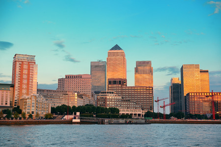 business district: Canary Wharf business district in London at sunset.