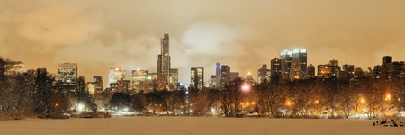 city night: Central Park winter at night panorama with skyscrapers in midtown Manhattan New York City Stock Photo
