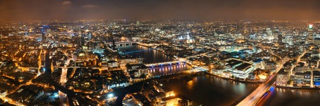 London aerial view panorama at night with urban architectures and bridges. Stock Photo