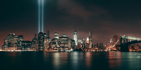 new york at night: New York City downtown Brooklyn Bridge and september 11 tribute at night