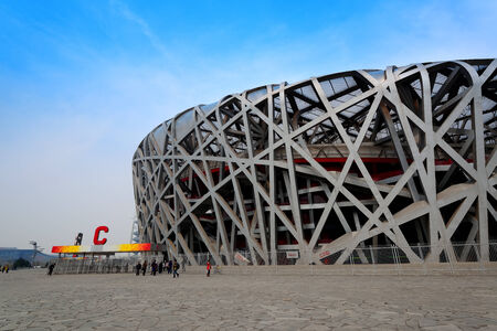 summer olympics: BEIJING, CHINA - APR 7: Beijing National Stadium with blue sky on April 7, 2013 in Beijing, China. The stadium was established for the 2008 Summer Olympics and Paralympics. Editorial