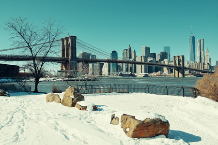 winter: Brooklyn Bridge closeup with snow in winter in New York City