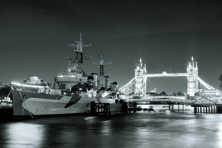 belfast: HMS Belfast warship and Tower Bridge at night in Thames River in London