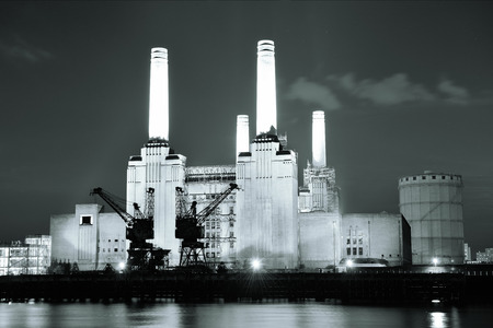 Battersea Power Station over Thames river as the famous London landmark at night. photo