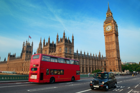 english famous: Double-deck red bus on Westminster Bridge with Big Ben in London.