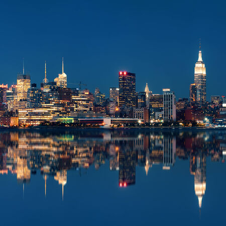 empire state: Midtown Manhattan skyline at dusk panorama over Hudson River with reflections