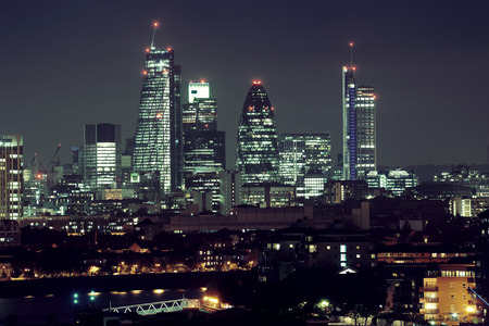 thames: London cityscape with urban buildings over Thames River at night Stock Photo