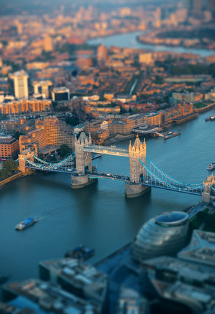 london tower bridge: London rooftop view with Tower Bridge at sunset with urban architectures.