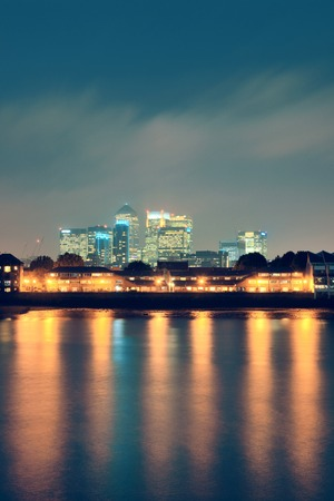 wharf: Canary Wharf in London over Thames River. Stock Photo