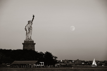 bw: Statue of Liberty and full moon in BW in New York City