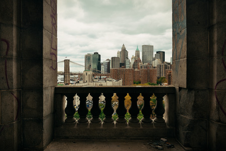 abandoned city: New York City downtown architecture skyline through abandoned balcony. Editorial