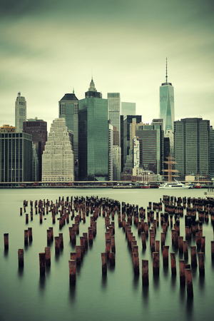 abandoned city: Manhattan financial district with skyscrapers and abandoned pier over East River.