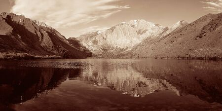 convict lake: Snow mountain and lake BW with reflections panorama in Yosemite. Stock Photo