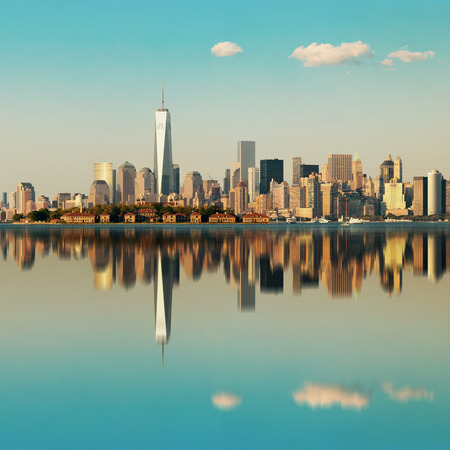 new york skyline: Manhattan downtown skyline with urban skyscrapers over river with reflections. Stock Photo