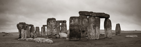 stonehenge: Stonehenge panorama in black and white with cloud near London as the National Heritage site of UK.