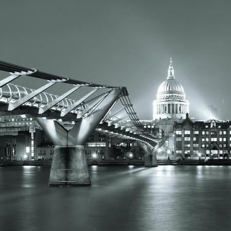 st pauls: Millennium Bridge and St Pauls Cathedral at night in London