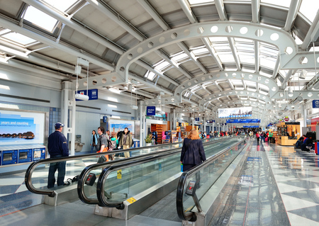 voted: CHICAGO, IL - MAR 31: Chicago OHare Airport interior on March 31, 2013 in Chicago, Illinois. It is the worlds second busiest airport and was voted the Best Airport in North America for 10 years