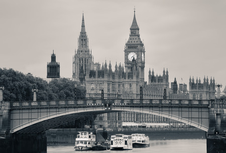 the palace of westminster: Westminster Palace and bridge over Thames River in London in black and white