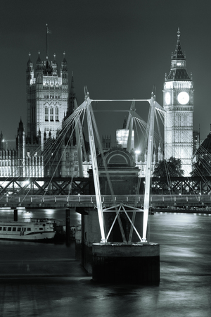 palace of westminster: Westminster Palace and bridge over Thames River in London at night Stock Photo