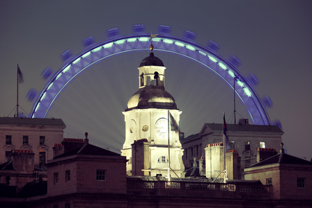 historical buildings: London Eye and historical buildings at night