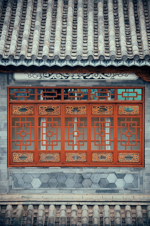 chinese courtyard: Local Bai style architecture roof and window in Dali old town. Yunnan, China. Stock Photo