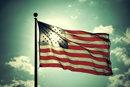 United States National Flag flying in sky