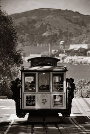 cable car: San Francisco, CA - MAY 11: Cable car in street on May 11, 2014 in San Francisco. It is the worlds last manually-operated cable car system