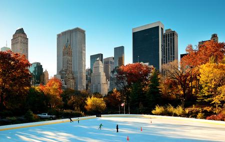 city park skyline: Central Park Autumn ice rink midtown skyline in Manhattan New York City Stock Photo