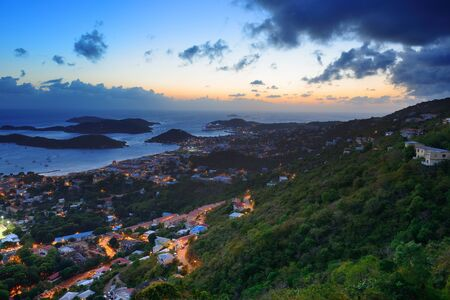 virgin islands: Virgin Islands St Thomas sunset mountain view with colorful cloud, buildings and beach coastline.