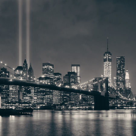 new york city panorama: New York City downtown Brooklyn Bridge and september 11 tribute at night
