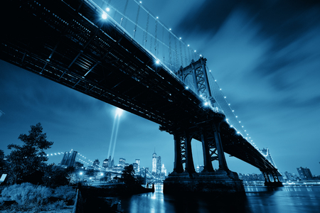 tribute: New York City downtown and september 11 tribute at night with Manhattan Bridge Stock Photo