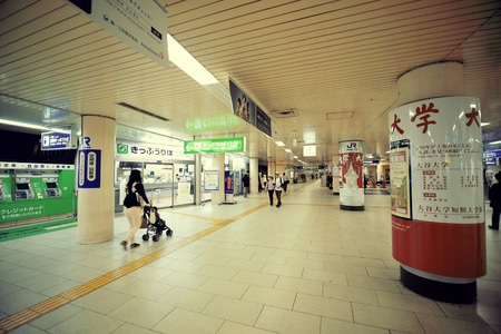 former years: KYOTO, JAPAN - MAY 18: Subway station interior on May 18, 2013 in Kyoto. Former imperial capital of Japan for more than one thousand years, it has the name of City of Ten Thousand Shrines.