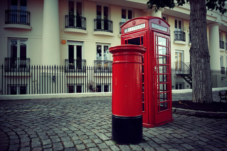 telephone box: Telephone box and mail box in London street. Stock Photo
