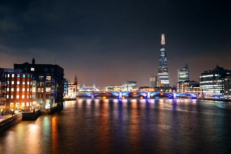 southwark: Southwark Bridge and London skyline at night.