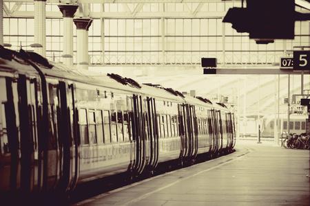 black train: Train on platform in station in London