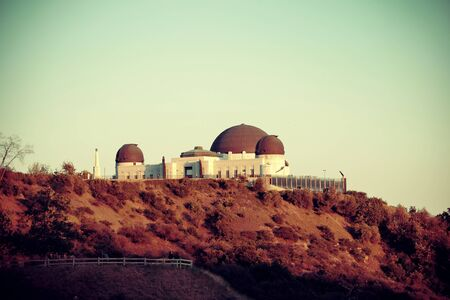 observatory: Griffith Observatory over mountain in Los Angeles. Stock Photo