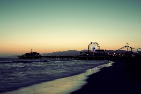 santa monica: Santa Monica Pier on beach in Los Angeles Stock Photo