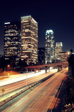 light trail: Los Angeles downtown at night with urban buildings and light trail