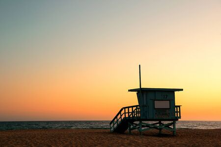 Santa Monica beach safeguard tower at sunset in Los Angeles